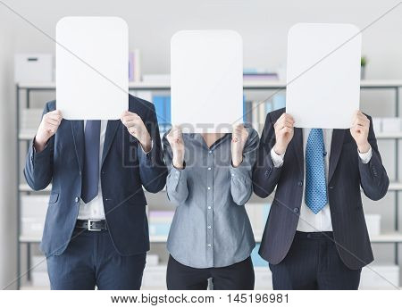 Business People Holding A White Sign