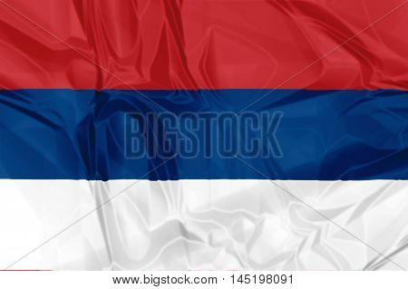 The national Serbia waving flag in 3d background.