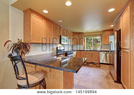 Maple Kitchen Cabinetry, Granite Counter Top And Tile Floor
