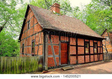 Old Salem North Carolina - April 21 2016: 1767 Moravian Third House constructed of brick and half-timber on Main Street *
