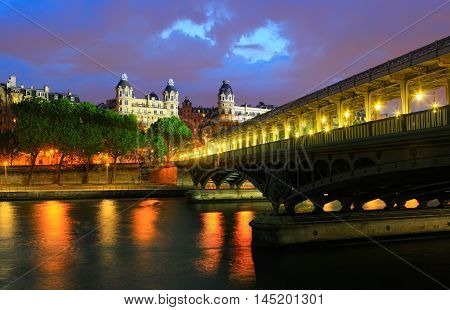 Paris, France - May 27, 2016: Paris at night on May 27, 2016 in Paris. View of city and bridge pont de Bir-Hakeim that crosses the Seine River in Paris, France.