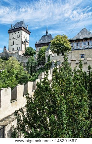 Karlstejn is a large gothic castle founded 1348 by Charles IV in Czech republic. Ancient architecture. Travel destination. Vertical composition.