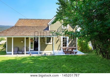 Green Olive Exterior Paint Of Clapboard Siding House
