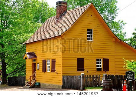 Old Salem North Carolina - April 21 2016: The 1771 wood frame Miksch House with extended back addition and central chimney *