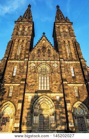 Beautiful basilica of Saint Peter and Saint Paul Vysehrad Prague Czech republic. Sunset photo. Vertical composition. Religious architecture. Travel destination.