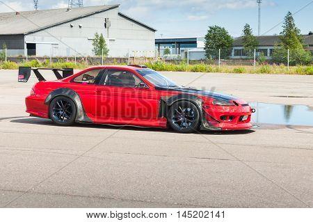 Red Custom Toyota Car Goes Down The Street