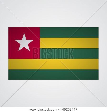 Togo flag on a gray background. Vector illustration