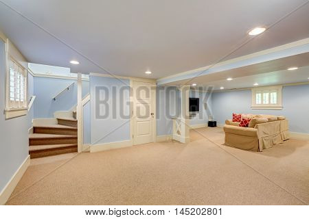 Spacious Basement Room Interior In Pastel Blue Tones