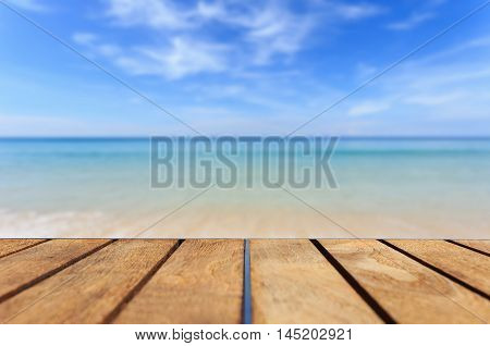 Top Of Teak Wood Table And View Of Sea And Blue Sky
