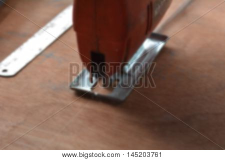 Blur image for jig saw working on wooden