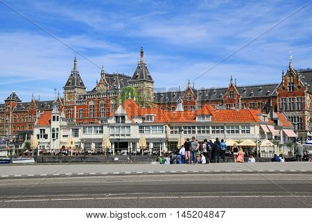 Amsterdam, Netherlands - May 13, 2016: Amsterdam Centraal Train Station on May 13, 2016 in Amsterdam. Station Amsterdam Centraal  major national railway hub. Used by 260,000 passengers a day