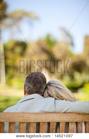 Happy retired couple sitting on the bench