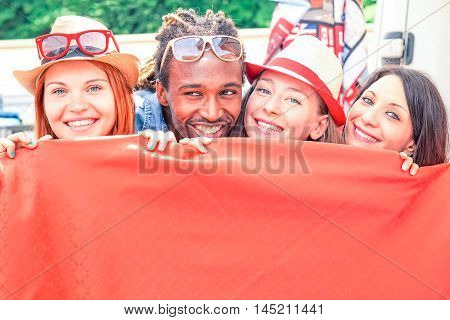 Happy interracial family playing hide and seek outdoors - Multiracial smiling friends in a row having fun at daily flea market - Concept of cheerful people with childish attitude -