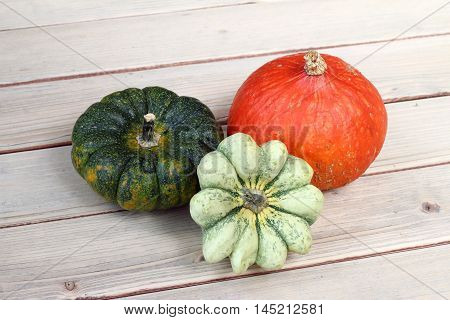Detail of the pumpkins on wooden board