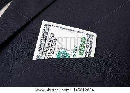 United States dollar (USD) bills - in businessman suit pocket