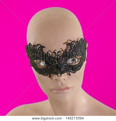 Portrait Of Mannequin Female With Black Mask Isolated On Purple Background