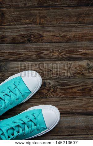 sneakers on empty wooden floor