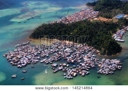 KOTA KINABALU/MALAYSIA - 23 NOVEMBER 2015: Village on the water on Gaya Island. Although Borneo is one of the richest Malaysia's regions, income inequality rate is extremely high