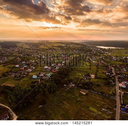 Panoramic view of the Kiev suburb in the sunset from above. Aerial view. Outdoor.