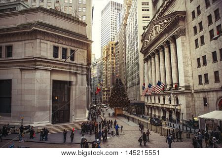NEW YORK CITY - DECEMBER 15: Wall Street with New York Stock Exchange in Manhattan Finance district during Christmas December 15 2015 in Manhattan New York City.