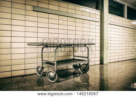 Old vintage metal stretcher in horror hospital