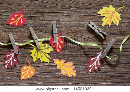 Autumn Background With Colored Paper Sheet On A Wooden Board. A Sheet Of Paper Craft For Children. C