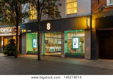 NOTTINGHAM ENGLAND - AUGUST 30: Frontage of the EE mobile store at night on Clumber Street. In Nottingham England. On 30th August 2016.