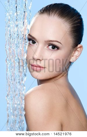 Woman With Clean Skin And Stream Of Water