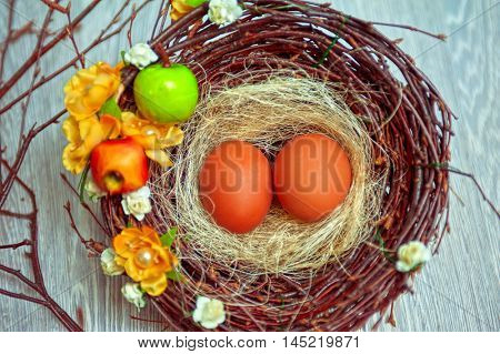 eggs in nest on a wooden background for easter