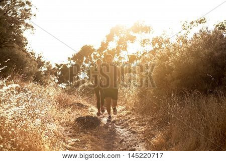 Very Young Couple Running On Gravel Path