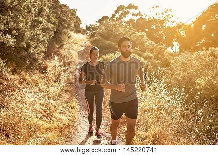 Pretty Girl Running Behind Bearded Guy