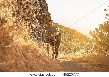 Lovely Young Couple Running In The Mountain