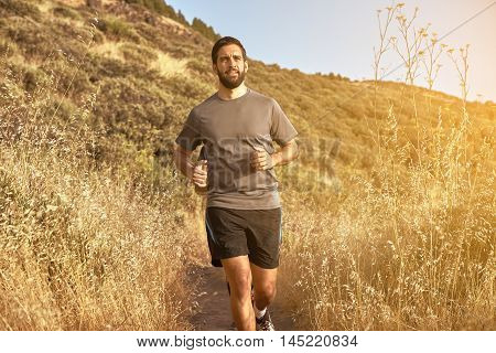 Jogging Young Male With A Full Beard