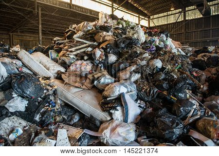 Large heap of garbage inside a waste plant