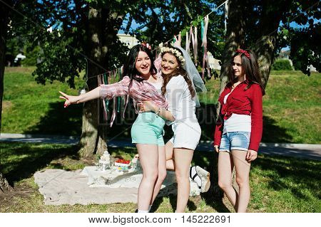 Three Cheerful Beautiful Girls In Short Shorts Posed Background Decoration At Bachelorette Party