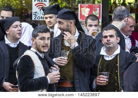CAGLIARI, ITALY - May 1, 2015: 359th Religious Procession of Sant'Efisio - Sardinia - group of people in traditional Sardinian costumes that come together to cry