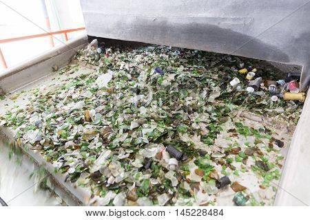 Glass Waste In Recycling Facility. Glass Particles In A Machine
