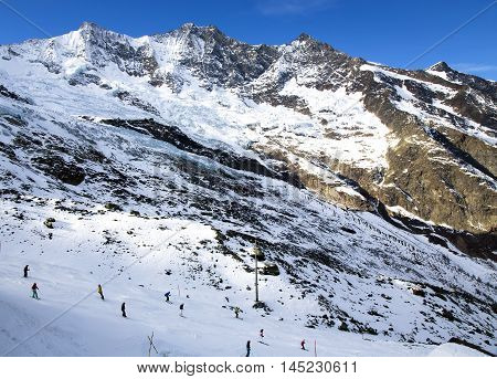 SWITZERLAND, SAAS-FEE, DECEMBER, 26, 2015 - View from above on Felskinn snow sports routes with wide glacial slopes and natural snow, offers an unequalled range of winter sports opportunities. Varied routes for freeriders and snowboarders at an altitude o