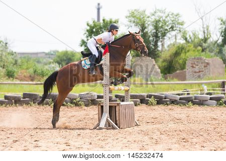 Volgograd, Russia - June 19, 2016: Sportsman On Horse Jumping Over A Hurdle In The Jumping Competiti