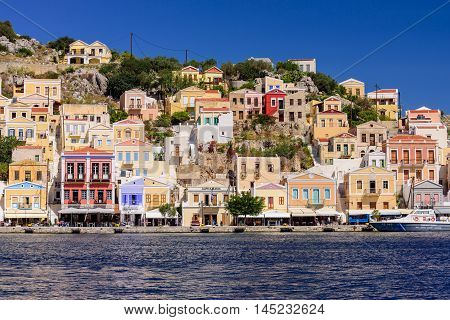 Symi island, Greece - May 18, 2016: the scenic waterfront with colourful houses of Symi, in May 18, 2016, Symi island, Dodecanese, Greece.