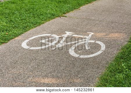 Bicycle path. Bicycle symbol on street. Road cycling