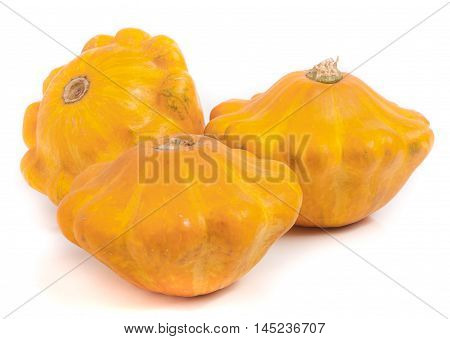 three yellow pattypan squash isolated on white background.