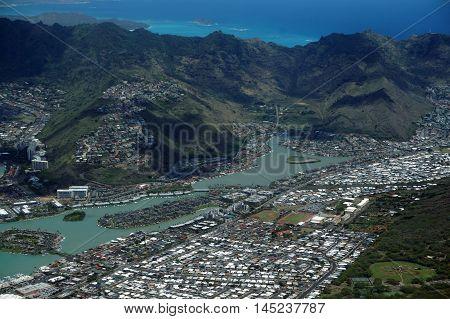Aerial view of Kuapa Pond Hawaii Kai Town Windward coast clouds and Pacific Ocean on Oahu Hawaii. April 2016.