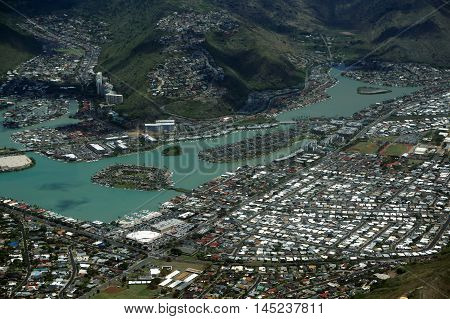 Aerial view of Kuapa Pond Hawaii Kai homes Town clouds and Pacific Ocean on Oahu Hawaii. April 2016.