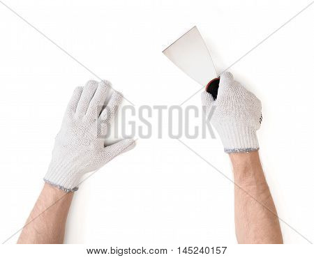 Close-up view of man's hands in white cotton gloves with a putty knife isolated on white background. Wall repairing. Home improvement. Handyman.