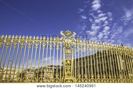 High gilded gate guarding Versailles Palace, France