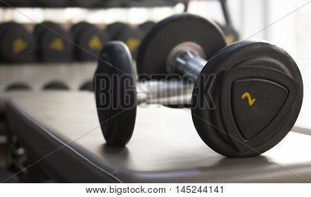 Close-up view of dumbells in the gym.