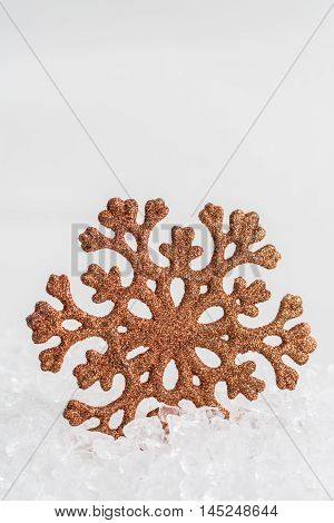 Golden snowflake on white chrystal background Christmas concept
