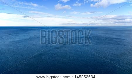 Blue sea and sky taken from an elevated position