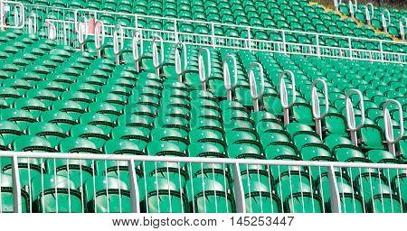 Green seats on an outdoor concert stadium